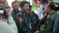 Deputy commander-in-chief of the Kachin Independence Army (KIA), Maj-Gen Guam Maw (left), shakes hands with a senior Burma official as they meet for talks in Myitkyina, Kachin state, 28 May 2013