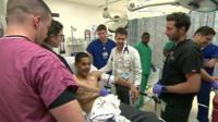 Doctors attending gunshot victim
