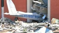Plane wreckage in side of building