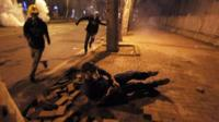"""A protester falls down as others run to avoid tear gas during the third day of nationwide anti-government protest near the Prime Minister""""s office at Besiktas area in Istanbul,"""