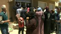 Refugees queuing