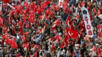 "Anti-government protesters wave flags during a rally in Istanbul""s Taksim square"