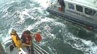 French authorities and British crewmen during their operation to rescue 10 people from the English Channel