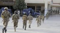 Pakistani paramilitary soldiers take position after militants attacked a hospital in Quetta