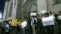 Protestors on the steps of Sao Paulo Cathedral