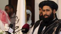 Muhammad Naeem a representative of the Taliban speaks during a press conference at the official opening of their office in Doha, Qatar