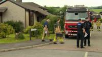 Firefighters and police at fatal Llanrwst bungalow fire