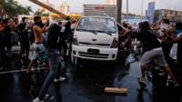 Protesters destroy a van during a demonstration in Belo Horizonte, Brazil