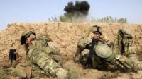 British troops take cover as they shelter from a controlled explosion of an Improvised Explosive Device (IED) in a village of Sayedebad District, Nad e Ali, Helmand Province
