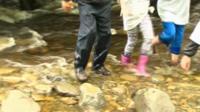 Ysgol John Bright pupils from Llandudno in a stream