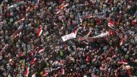 """Anti-Mursi protesters carry a banner saying """"leave"""""""