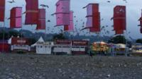 The field in front of the Other Stage is covered in litter at the Glastonbury music festival