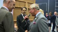 Prince Charles speaks into the Dalek voice machine