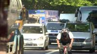 Cyclist on busy road