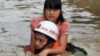 Rescuer carrying girl