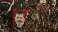 Pro-Morsi demonstrators with flags and posters