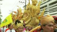 Giant candles being paraded through the streets of Thailand
