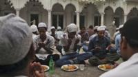 Indian Muslims offer prayers before breaking fast during the holy month of Ramadan