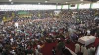 People attend the funeral service of victims of a coach crash at the Monteruscello Palasport