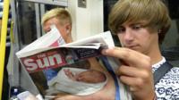 Man reads Sun newspaper