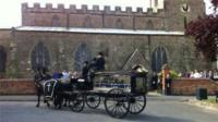 The horse drawn hearse at Susan Taylor's funeral