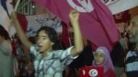 Protesters gather in support of Tunisia's governing Islamist movement