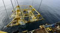 The extractor frame is lowered into the sea