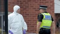 Forensic officer and police at scene