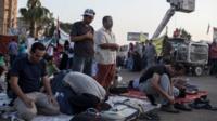 Supporters of deposed Egyptian President Mohammed Morsi perform morning prayer