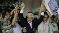 Palestinian President Mahmoud Abbas with released Palestinian prisoners, in the West Bank city of Ramallah