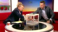 Bill Turnbull puts his hand into a box of mosquitos