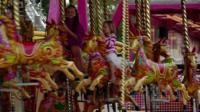 Children on merry-go-round