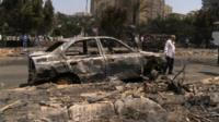 Burnt-out car at Rabaa al-Adawiya Square