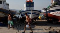 Fishermen walk at Atunara Port on August 17, 2013 in Linea de la Concepcion, Spain