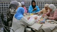 Women sewing bags