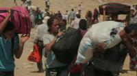 Syrian refugees crossing into Iraqi Kurdistan