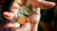 Elderly woman holding money