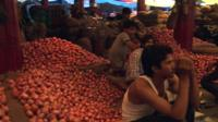 Piles of onions in market