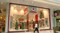 A Vodafone shop front in a shopping mall