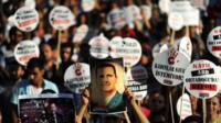 A protester holds a portrait of Syrian President Bashar al-Assad during a rally on September 1,