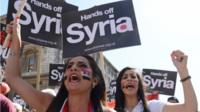 Demonstrators take part in a march in central London, to protest about military action in Syria on 31 August