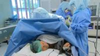 Paul Eaton undergoing surgery