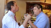 Anthony Weiner, left, who is seeking the Democratic nomination to run for the New York City Mayor's Office, has a heated argument with Shaul Kessler at Weiss Bakery in the Boro Park neighborhood in the Brooklyn borough of New York 4 September 2013