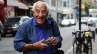 Victor Friedman on the street with his camera