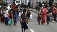 Residents flee from fighting between security forces and rebels from the Moro National Liberation Front (MNLF) who raided several villages in Zamboanga city