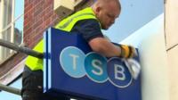 Workman polishes new TSB sign