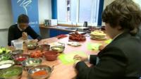 Pupils making curry