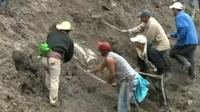 Rescue crew dig into debris caused by the mudslide