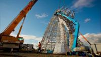 Workers putting The Kelpies in place