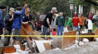 Residents try to divert floodwater from their homes in Boulder, Colorado